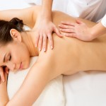 Massage on the back of woman