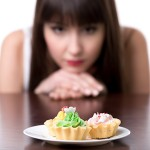 Dieting woman craving for cake